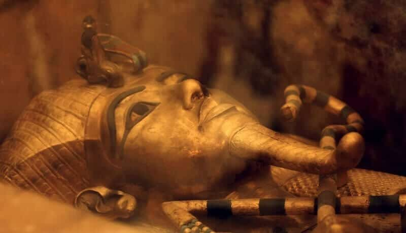 One of Egypt's famed King Tutankhamun's golden sarcophagus is displayed at his tomb in a glass case at the Valley of the Kings in Luxor, Egypt, Friday, April 1, 2016. Egypt's archaeologists have completed more extensive scanning of two recently discovered chambers behind King Tut's tomb in the Valley of the Kings. (AP Photo/Amr Nabil)